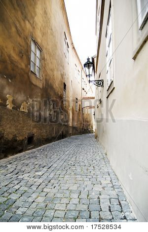 A small skinny moody street detail in the old town area of Prague, Czech Republic.