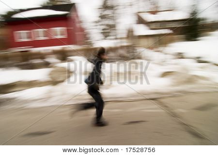 A motion blur abstract of a person walking in a hurry, a late rushing concept image.