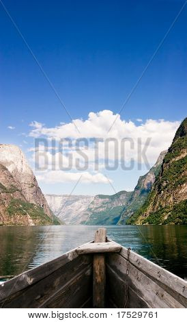 An old boat on a majestic norwegian fjord
