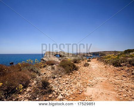 A dry dusty path on the island of Comino, Malta