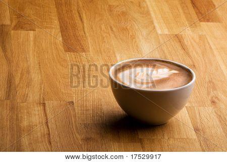Cafe latte on a wood table with copy space