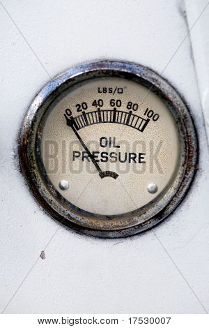 An old retro steampunk style oil pressure gauge