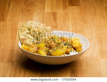 An Indian meal - Potato curry with Lentis and Naan bread
