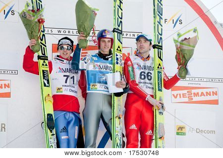 VIKERSUND, NORWAY - MARCH 15: Winners podium at the FIS World Cup Ski Jumping Competition. 1st: Gregor Schlierenzauer (Austria), 2nd: Simon Ammann (Switzerland), 3rd: Dimitry Vassiliev (Russia)
