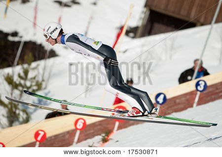 VIKERSUND, NORWAY - MARCH 15: Johan Remen of Norway competes in the FIS World Cup Ski Jumping Competition on March 15, 2009 in Norway.