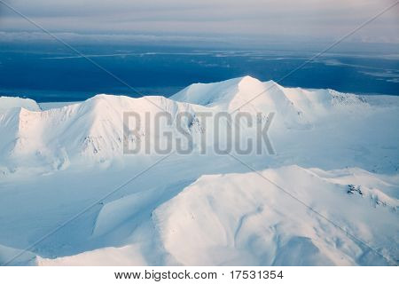 A mountain landscape filled with snow, Svalbard, Norway