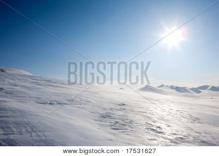 A winter landscape with blowing snow on Spitsbergen Island, Svalbard, Norway