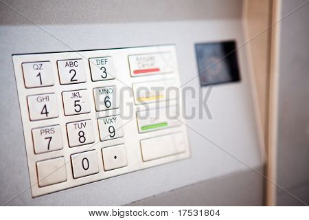 A close up detail of an outdoor bank machine; shallow depth of field with critical focus on middle row of numbers