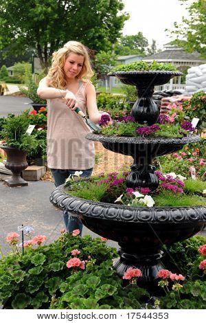 Young woman gardening in nursery