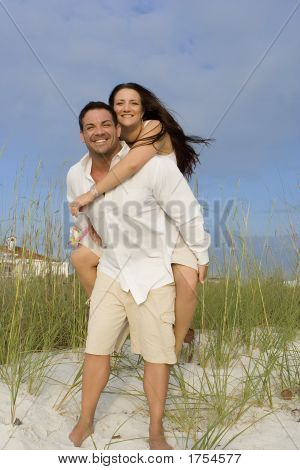 Happy Couple On A Beach
