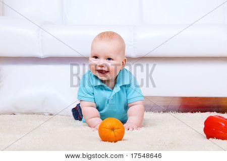Cheerful kid crawling on the floor