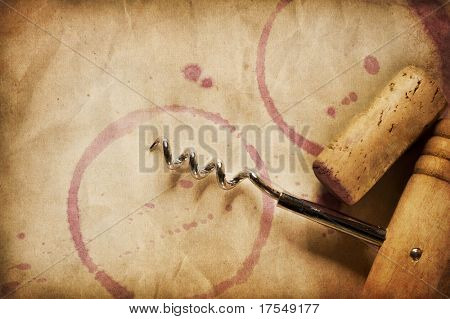 Wine Background. Wine Cork, Corkscrew and red wine stains on the vintage paper