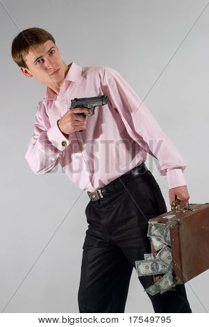 Man with gun and case of dollars