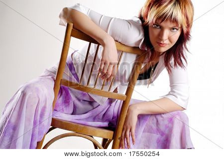 portrait of beautiful young woman sitting on the chair