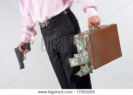 man with  a gun and case of dollars