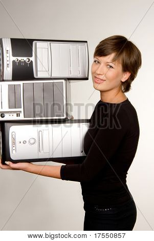 Pretty girl carrying three computers