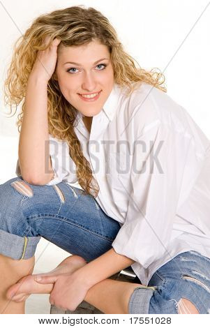 Pretty girl wearing white shirt and jeans