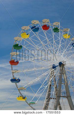 Tall Ferris wheel against sky background