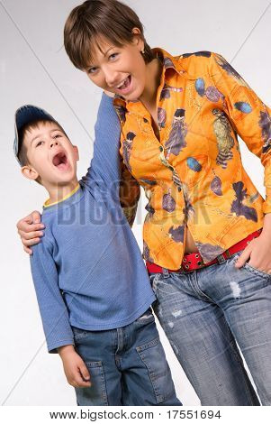 Happy mother and son singing or shouting. Isolated on white background