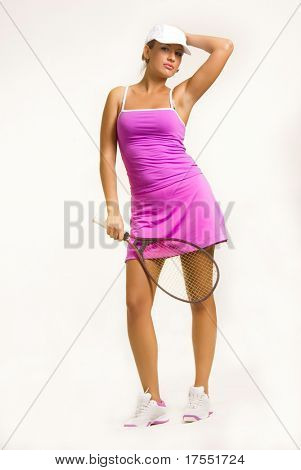 Beautiful young girl with tennis racket