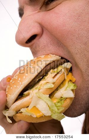 Man biting hamburger macro over white