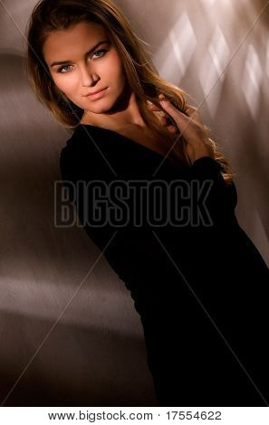 Sensual woman portrait in dark gamma
