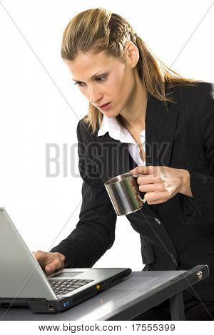 Businesswoman with laptop and cup of coffee isolated over white