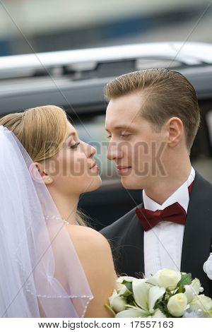 bride and groom over wedding car background