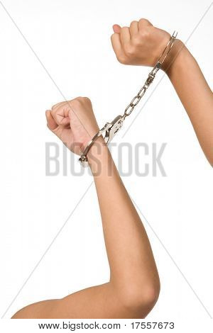 Woman's hand holding handcuffs isolated on white