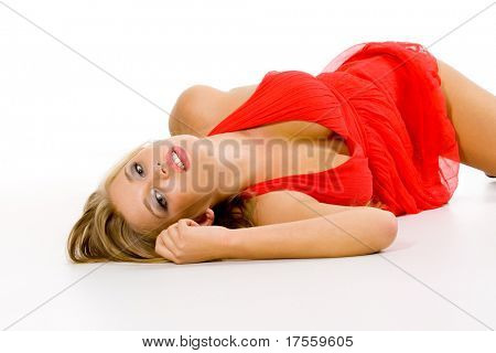Blonde of supernatural beauty dressed red isolated on white