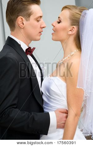 Vivid wedding shot of young bride and groom