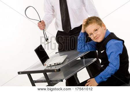 Father threatening son with a belt