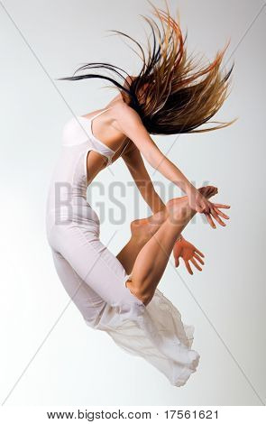 Young attractive blond jumping, isolated