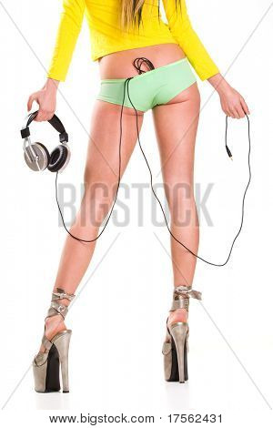 Sexy girl with headphones, cable thrusting under her panties