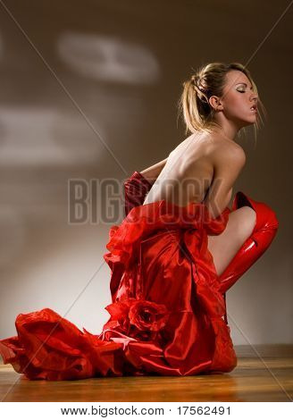 Pretty young girl, body partly covered by red dress
