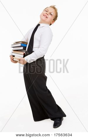 Little boy carrying books stack. Isolated