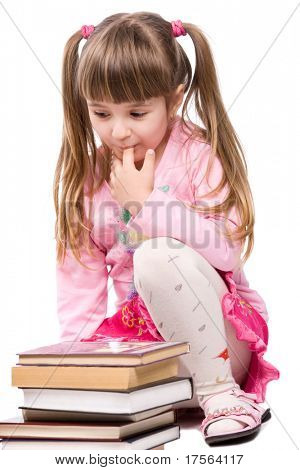 Pretty little girl with stack of books