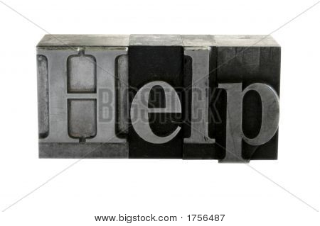 The Word 'Help' In Old Metal Letters
