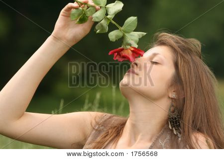 Beautiful Girl Smelling Red Rose