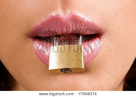 woman holding metal padlock  in her mouth