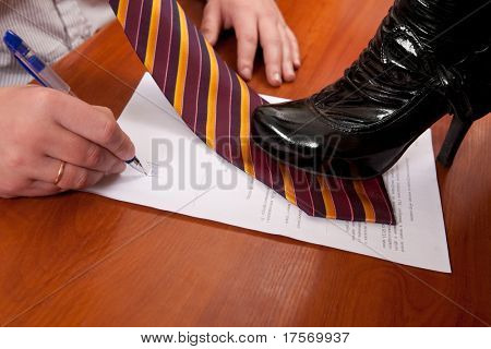 Woman urging an office worker to sign a contract