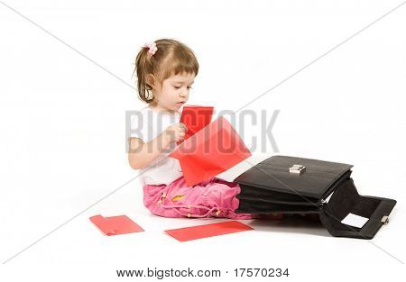 Little girl with dumping black father's  briefcase over white