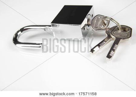 Metal padlock over white with keys