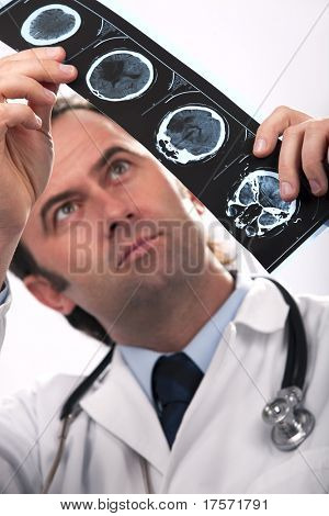 Medical doctor analyzing a CT scan isolated on white background