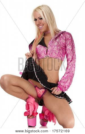 Coquettish blonde in pink pulls up her skirt