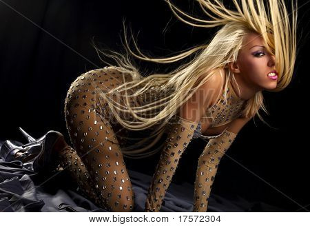 Pretty dancing girl with great fly-away hair in black background