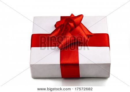 Gift decorated with a tape and a bow over gray background