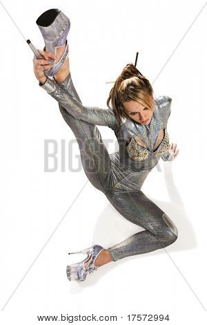 Attractive model wearing glossy clothing doing exercise