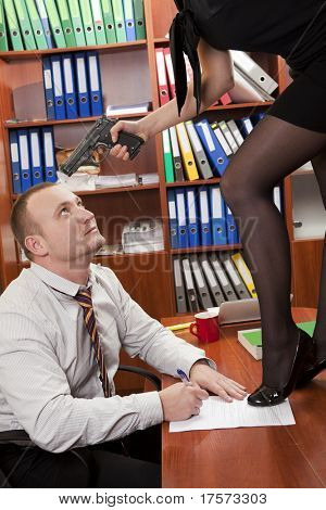 Woman aiming handgun at businessman convincing to cooperate