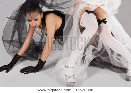 Two gorgeous young models like brides wearing black and white lingerie